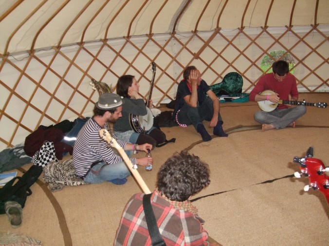 Adam Hurt (USA) teaching old time banjo inside the yurt at FiTM 2013