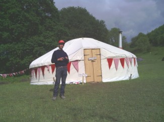 Ed Hicks outside the first Trad Academy workshop yurt at FiTM 2012